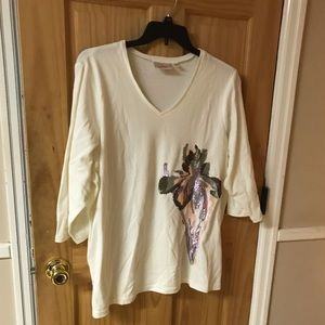 Vneck top with sequined iris pattern.
